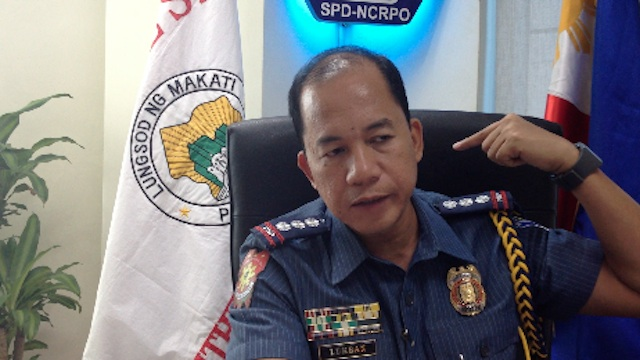 FATAL WOUND. Makati police chief Senior Supt. Manuel Lukban points to the exact spot where the victim received the fatal stab to his neck. Screenshot from video footage by Carlos Santamaria