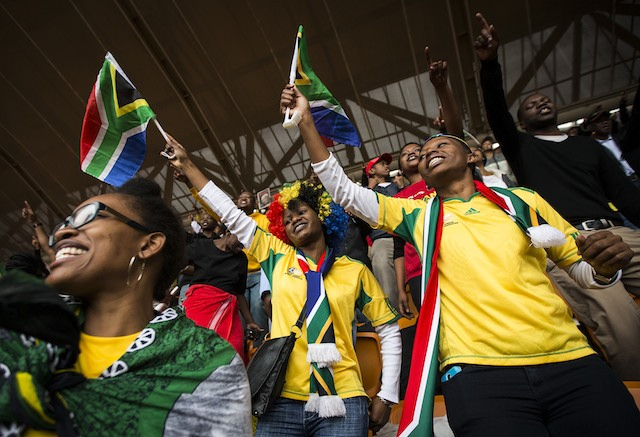 FOR MADIBA. Mourners wave South African flags ahead of the memorial service for the late Nelson Mandela at the FNB Stadium in Johannesburg, South Africa, 10 December 2013. EPA/Ian Langsdon