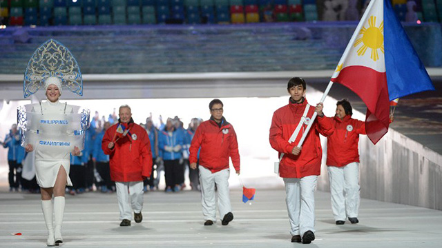 Martinez carries the Philippine flag during last Friday's opening ceremony. Photo by Andrej Isakovic/AFP