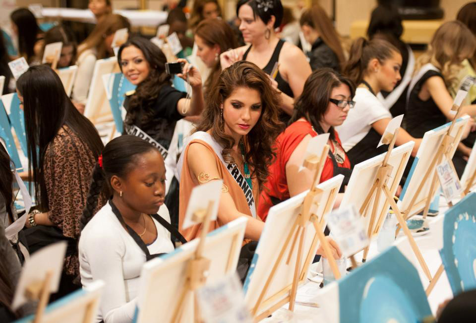 Miss France Marie Payet and the others hard at work on their artwork. Photo courtesy of the Miss Universe Organization LP, LLLP