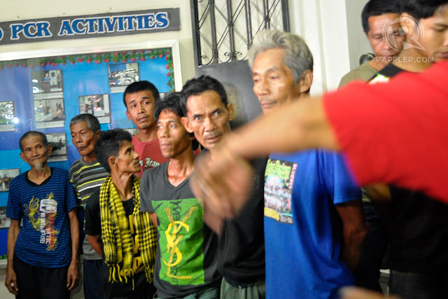 HUNGRY REBELS. The 15 MNLF members inside the Zamboanga City Police Office. Photo by Rappler/LeAnne Jazul