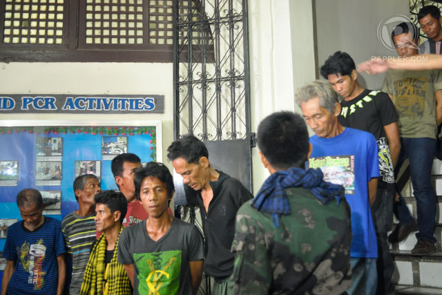'TIRED ANG HUNGRY': Another batch of 15 MNLF rebels surrendered to combined forces of the military and the police. Photo by LeAnne Jazul