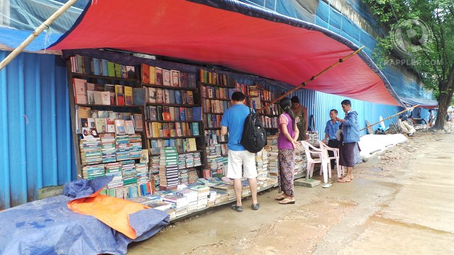 READING CULTURE. Makeshift bookstores sell books on the streets of Yangon. Books vary from secondhand novels to photocopied reference materials. Photo by Rappler, Ayee Macaraig/2013 SEAPA Fellow