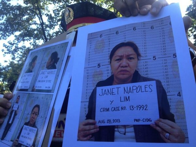 MUGSHOTS: Police officers show the media mugshots of Janet Lim Napoles. Photo by Paterno Esmaquel/Rappler