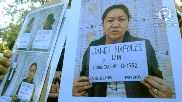 MUGSHOTS. Police officers show mugshots of Janet Lim Napoles. File photo by Paterno Esmaquel II/Rappler