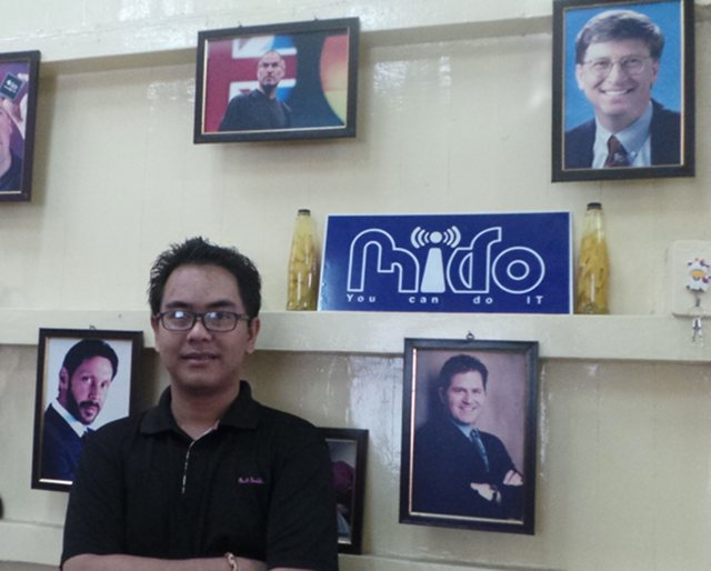 PRISON TO PARLIAMENT. Blogger and former political prisoner Nay Phone Latt is now working to help amend the law that sent him to jail. He lobbies for greater freedom of expression in ICT bills. He is photographed in his office in Yangon, Myanmar. Photo by Rappler/Ayee Macaraig, 2013 SEAPA Fellow