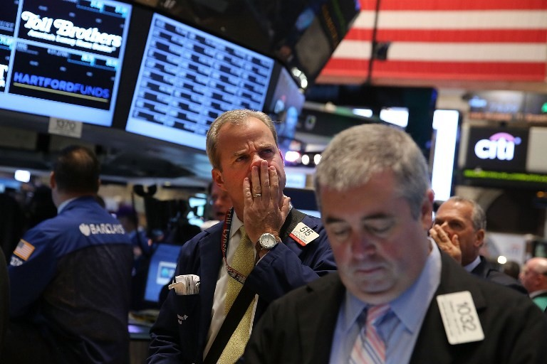 STOCKS DOWN. Traders work on the floor of the New York Stock Exchange during morning trading on September 30, 2013 in New York City. As a U.S. government shutdown looms, stocks fell sharply in the opening minutes of trading Monday. Spencer Platt/Getty Images/AFP