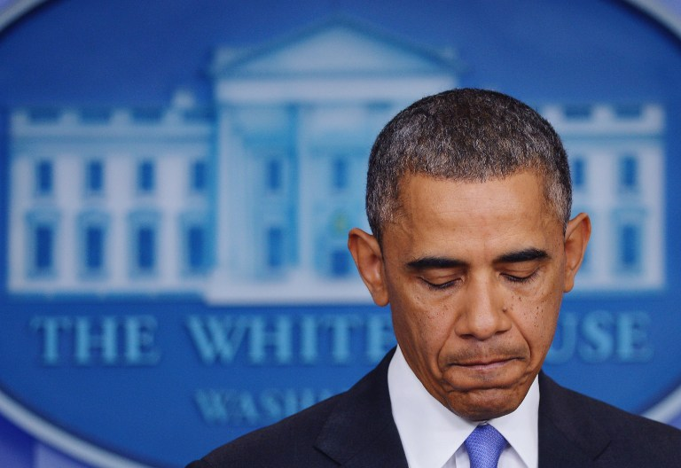 FACE OF DISAPPOINTMENT. US President Barack Obama pauses as he speaks on the Affordable Care Act in the Brady Press Briefing Room of the White House while reporters do stand-ups on November 14, 2013 in Washington, DC. AFP/Mandel Ngan
