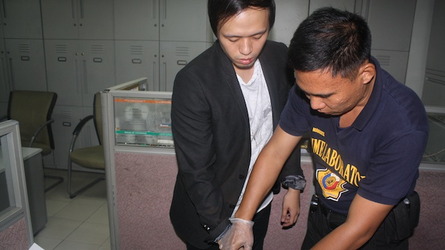 INDICTED. Cabrera is fingerprinted before being booked for the crime at the Makati police station after his arrest. Photo courtesy of Makati police