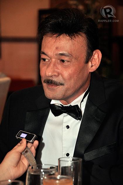 Mark Gil plays Larry Gomez