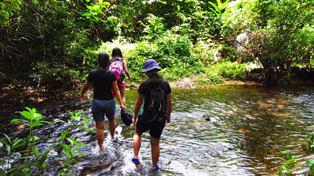 STREAM CROSSING. Dry bags are perfect for trips like this
