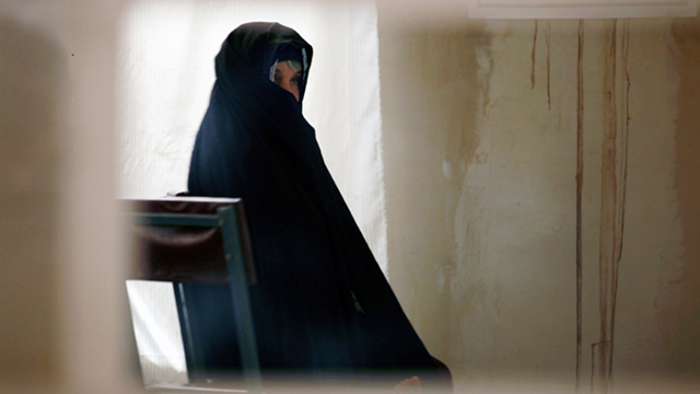 GLOBAL SCOURGE. A drug-addicted woman waits to undergo blood tests at a drop-in center supported by the UN in Herat, Afghanistan. Photo from UN Multimedia