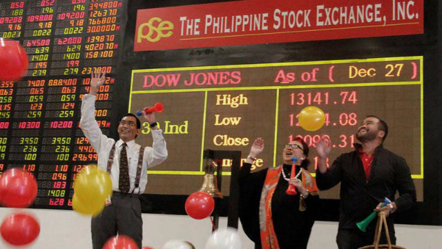 ENDS WITH A BANG. PSE President and CEO Hans Sicat, PSE Director Vivian Yuchengco, and PSE Chief Operating Officer Roel Refran at the last trading day ceremonies on December 28. Photo courtesy of the PSE.