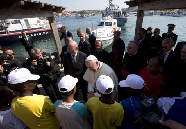 PRAYING FOR MIGRANTS. Pope Francis speaks with migrants during his visit to the island of Lampedusa, southern Italy, on July 8. Pope Francis arrives at the tiny Sicilian island of Lampedusa to pray for migrants lost at sea. Photo by EPA/Alessandra Tarantino/Pool.