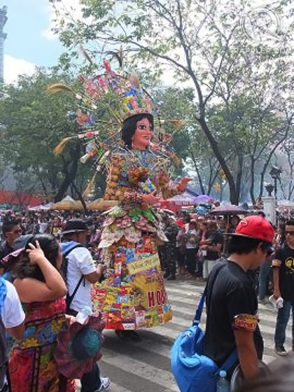 THE LADY. Reyna Juana in the form of a u0022higanteu0022 bears an image of the Santo Nino in her arms, a gift from Ferdinand Magellan after her baptism into the Catholic faith