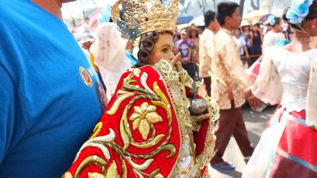 DEVOTEES of the Santo Nino bring their own image to the parade
