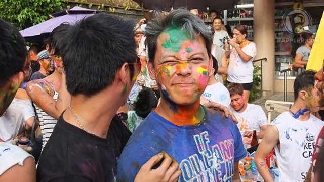 PAINT-SMEARED and loving it. Festival-goers did not shy away from sweat, paint and festive mayhem