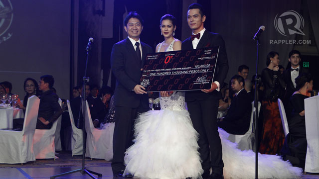 SHAINA MAGDAYAO AND JAKE Cuenca received a check for the Star Magic scholars