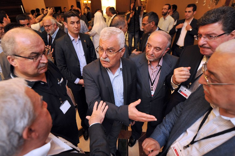 DISCUSSIONS. President of the Syrian National Council (SNC) George Sabra (C) talks with other Syrian opposition members during a break at the Syrian opposition meeting in Istanbul, on May 25, 2013. Photo by Ozan Kose/AFP