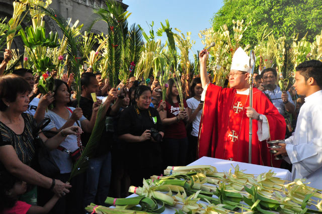 PALM SUNDAY. Manila Archbishop Luis Antonio Cardinal Tagle sprinkles holy water on palm fronds at the Manila Cathedral. Photo by Noli Yamsuan/Archdiocese of Manila