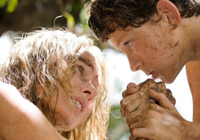 WET AND WIRED. Naomi Watts, with Tom Holland, holds on for dear life. All photos by Jose Haro/Summit Entertainment