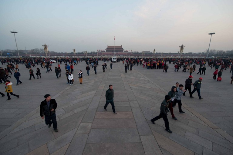 MORNING IN TIANANMEN. Tourists stand on Tiananmen Square to watch the daily flag-raising ceremony in Beijing early on March 5, 2013. Photo by Ed Jones/AFP