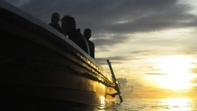 BEAUTIFUL SUNSET. Exhausted divers enjoy the view while returning to the boat to have dinner before a night dive