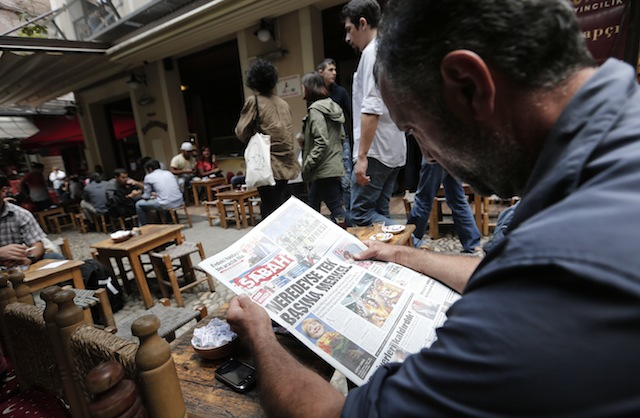 IN THE NEWS. A Turkish man reads a newspaper while sitting in a street cafe in Istanbul, Turkey, 23 September 2013. EPA/Sedat Suna