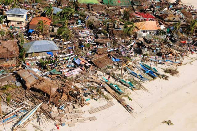 SEVERELY HIT. The coastline in Iloilo after typhoon Yolanda/Haiyan hit the province. Photo by AFP/Raul Banias