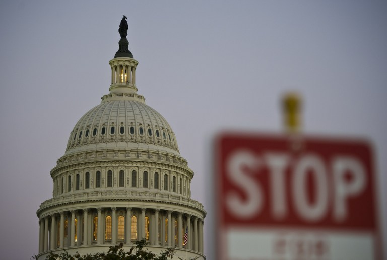 NOT OPEN FOR BUSINESS. The United States federal government went into a partial shutdown October 1, 2013, after Congress failed to pass a budget bill. In this photo, a stop sign is seen next to the US Congress building in Washington DC, September 30, 2013. AFP/Mladen Antonov
