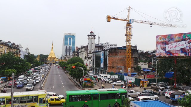 OLD, NEW. Yangon's classic pagodas and old colonial buildings now share the view with buildings under construction as the country's real estate market booms to meet investor demand. Photo by Rappler/Ayee Macaraig, 2013 SEAPA Fellow